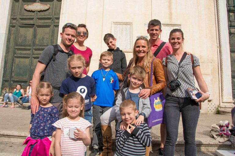 Family photo during a driving tour with Rome for kids