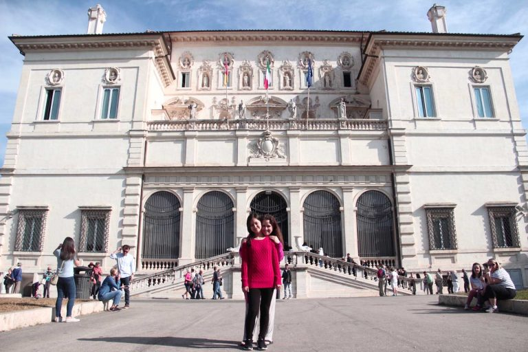 Family portrait in front of Borghese Gallery after a tour with Rome for kids