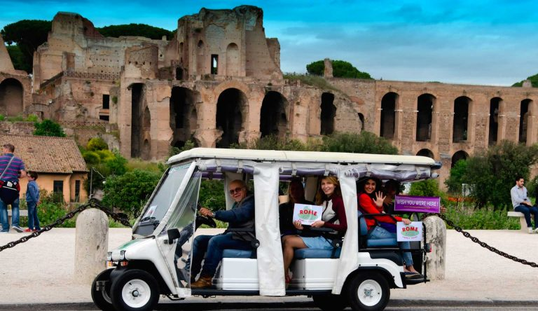 Tourists on a Golf Cart visit Rome. Rome for Kids can help you enjoy the city in a different way